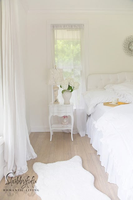 white nightstands and white bedding