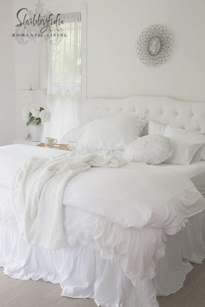 white bedding tufted headboard