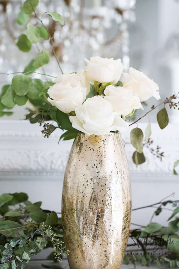 gold vase with roses