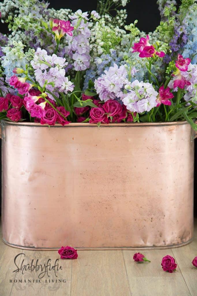 beautiful flowers in a copper pot