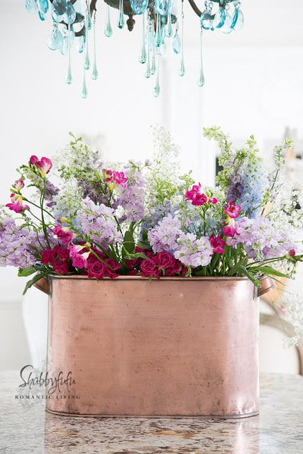 gorgeous flowers in a copper bucket