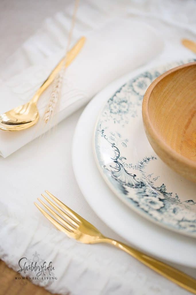 blue and white plate gold flatware