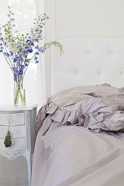 bed with gray ruffled bedding