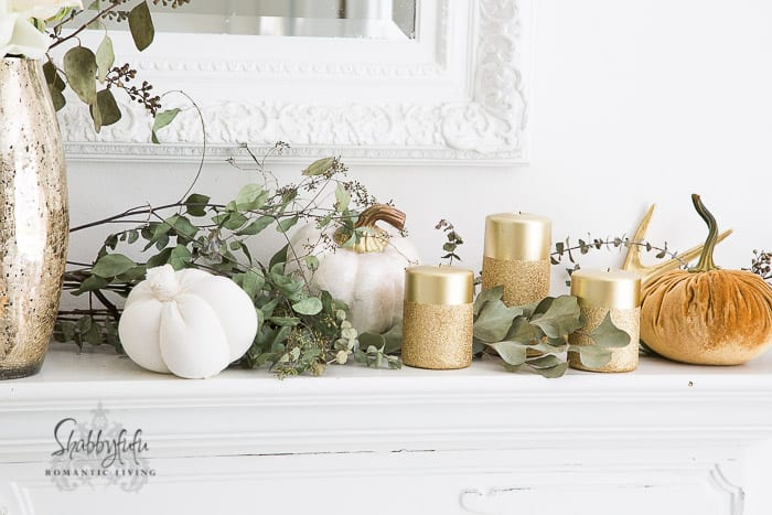 decorating a mantel for fall with gold