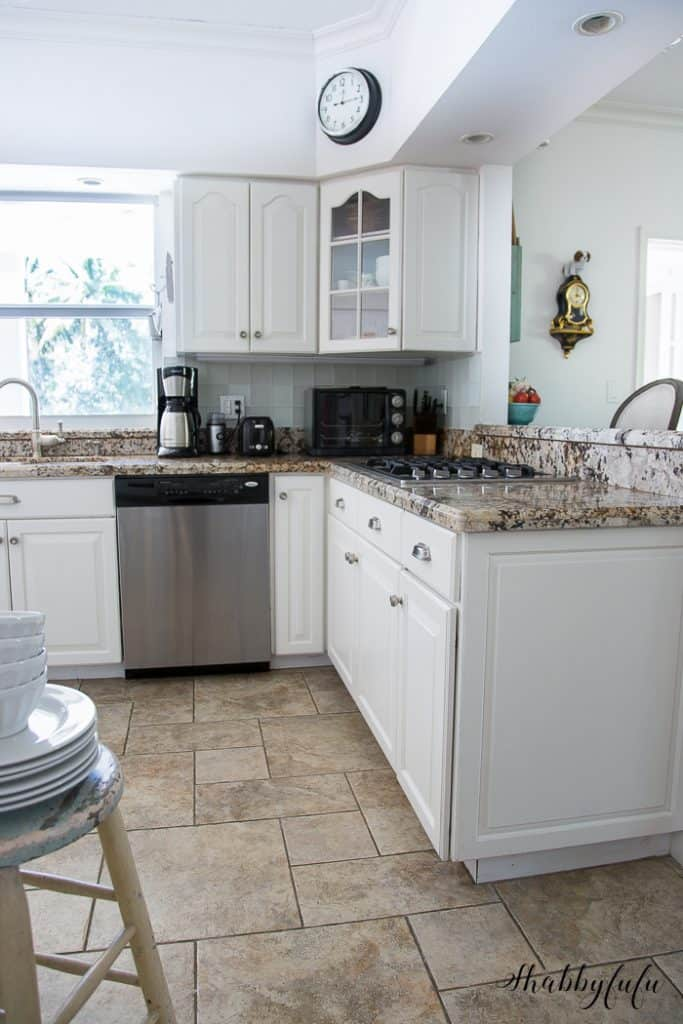 white kitchen with granite counter