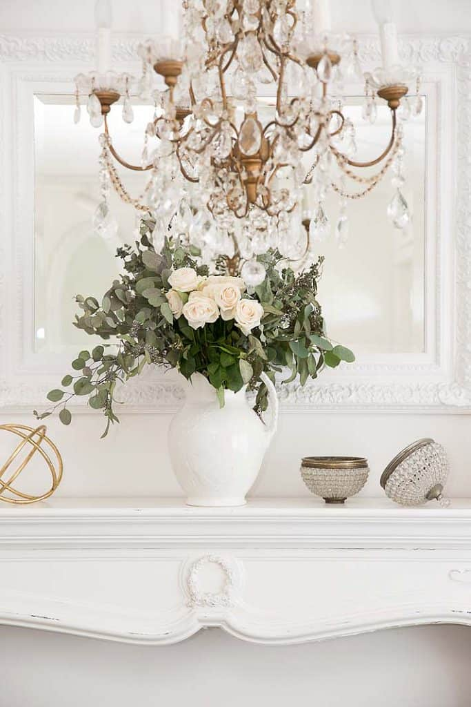 elegant white mantel with roses - transition to winter decorating