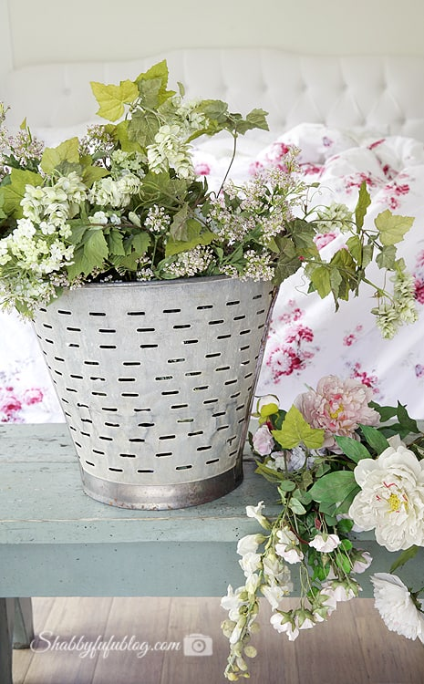 French farmhouse style vintage olive bucket with flowers