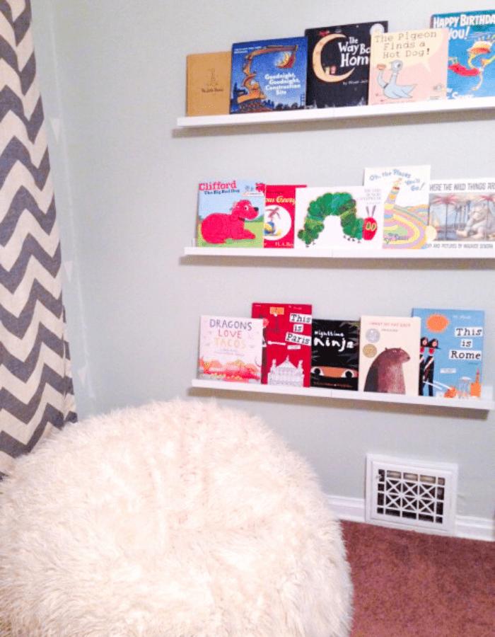 bookshelf on grey wall with children's books