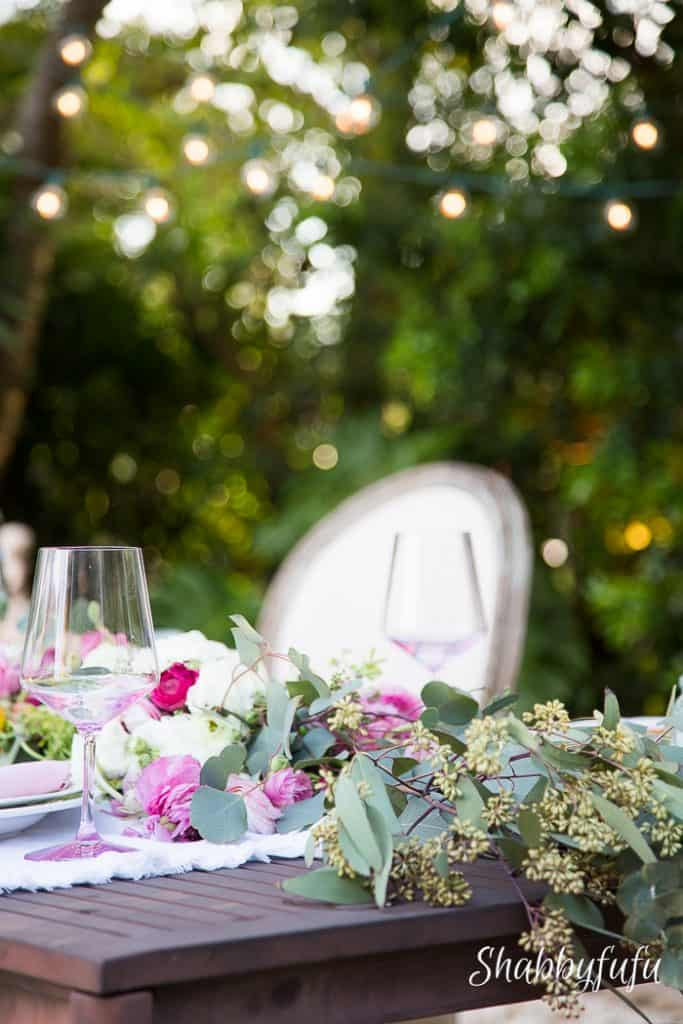 outdoor dining table with floral garland