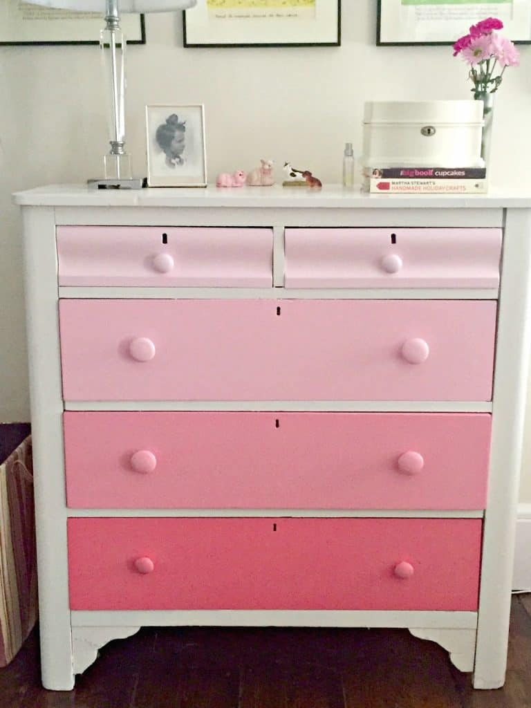 decorate a room with blush pink dresser