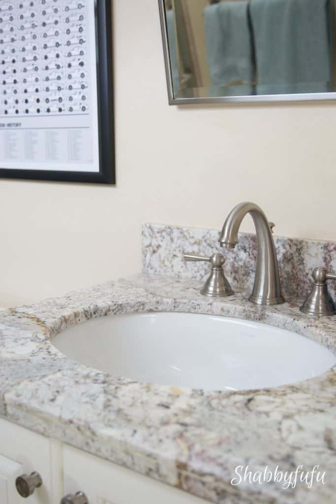 office bathroom with granite