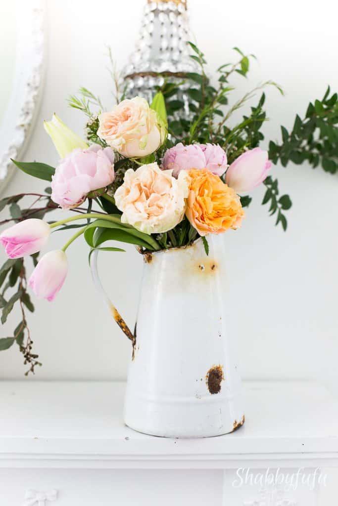 beautiful flower arrangement in french enamelware