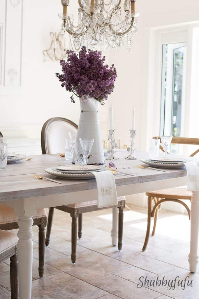 French farmhouse table setting with lilacs