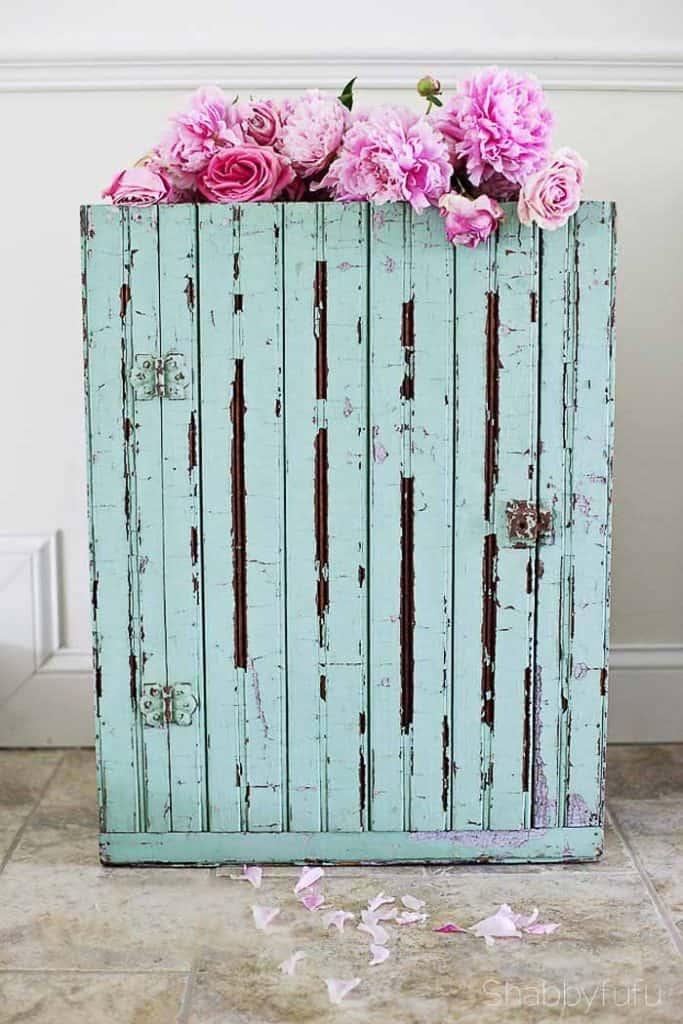 vintage green beadboard cabinet