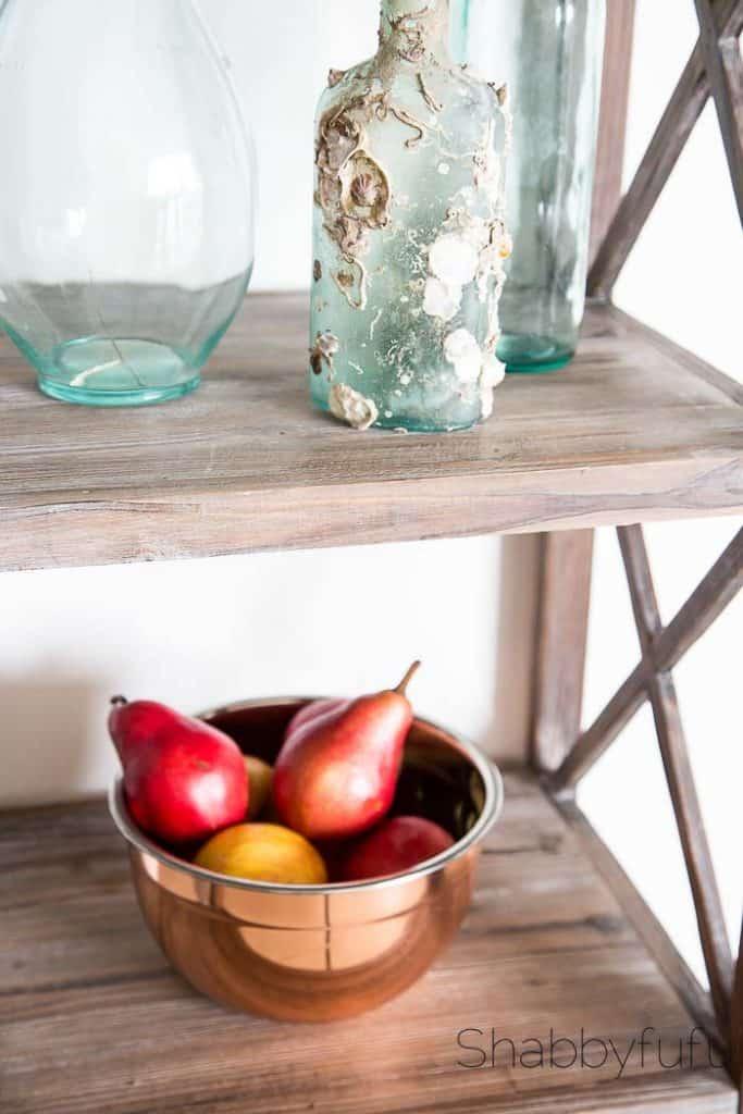 copper bowl and aqua beach glass bottles