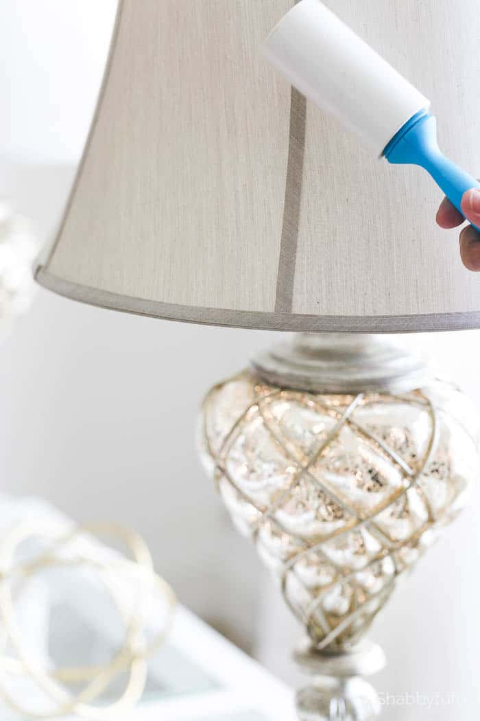 dusting a lampshade