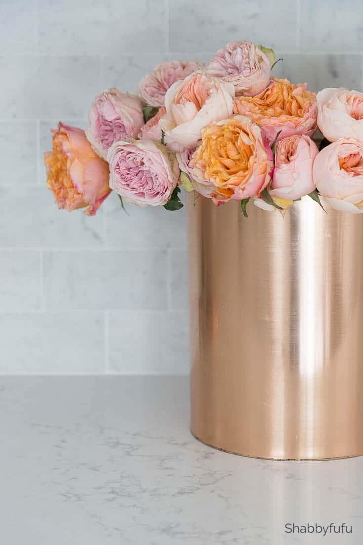 carrara marble tile backsplash with flowers
