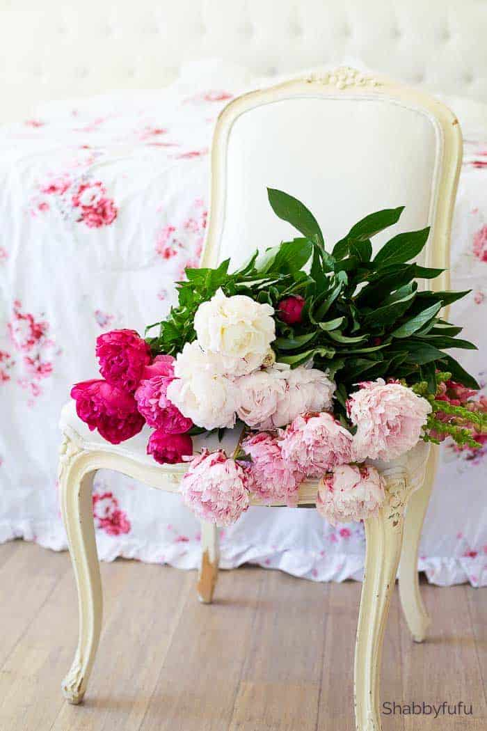 summer flower arrangements peonies on a chair