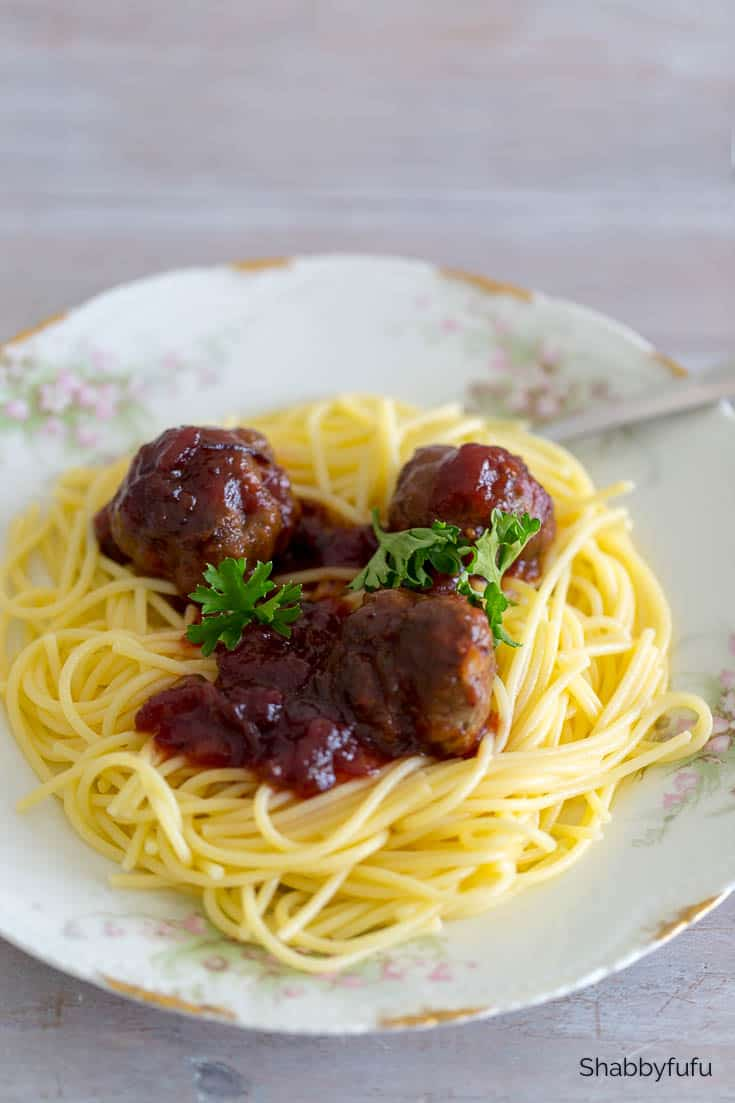 cranberry meatballs with chili sauce over pasta