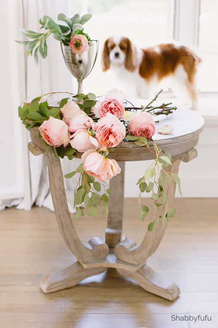 table with flowers how to tackle a bedroom makeover