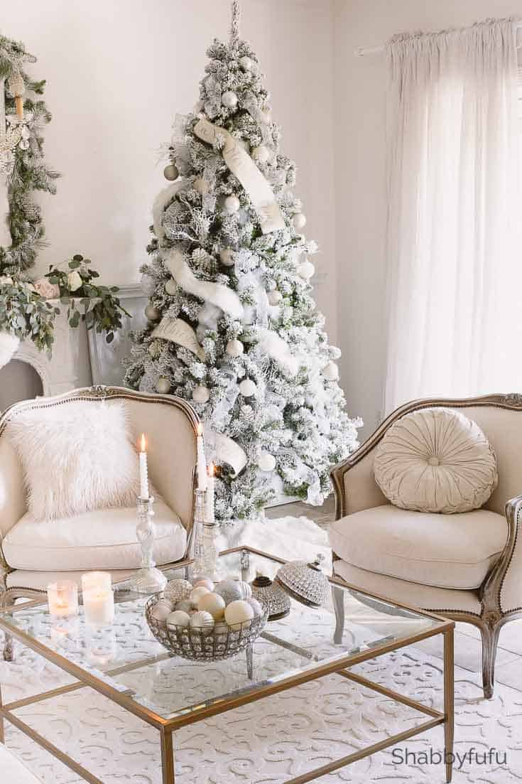 french country christmas in white with a king of christmas white flocked tree