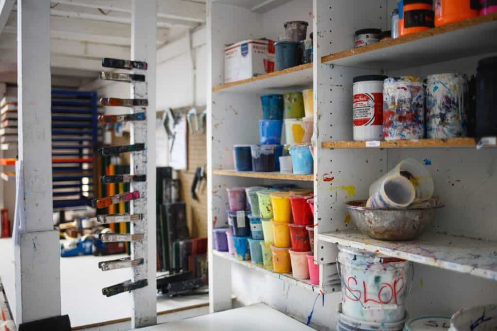 garage white shelves with paint bins