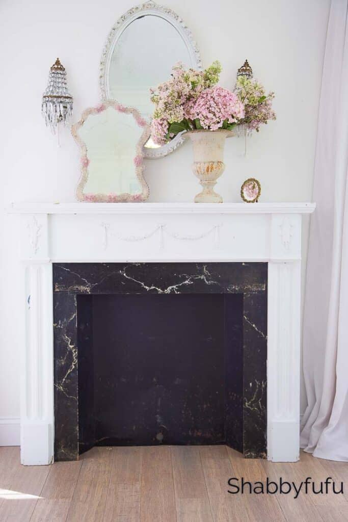 decorate with mirrors on a mantel