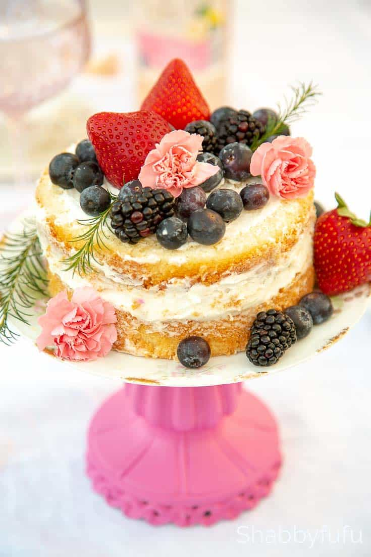 naked cake with berries and flowers