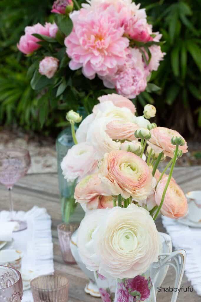 blush pink ranunculus and pink peonies