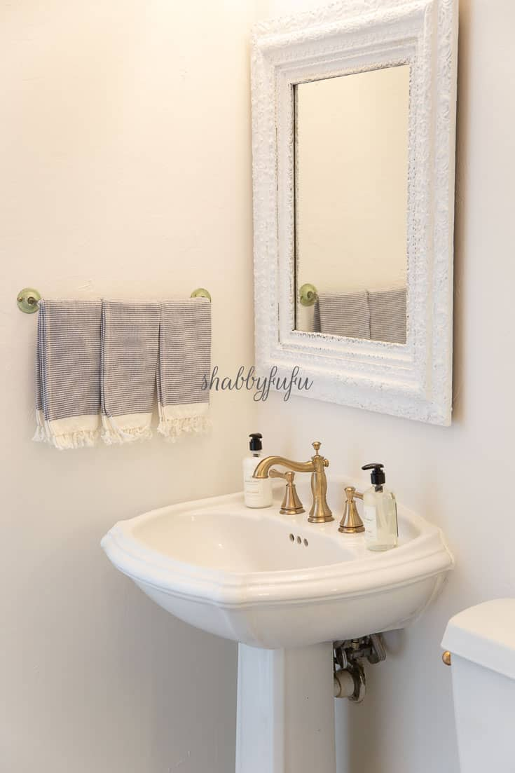 pedestal sink with vintage mirror