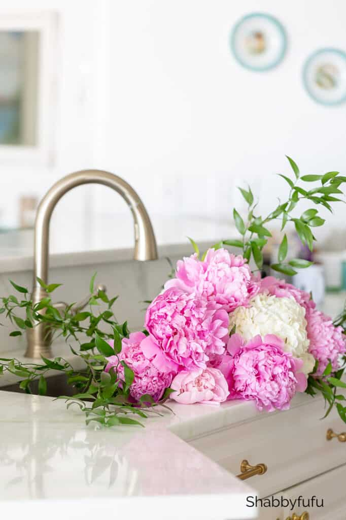 peonies and hydrangeas in the sink