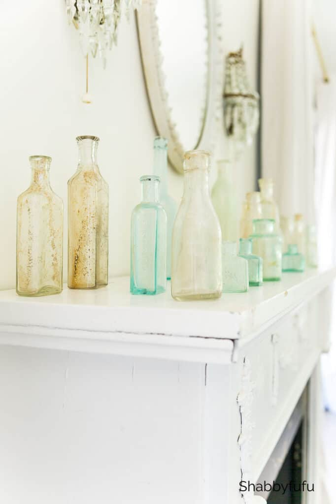 styling collections of old bottles on a mantel