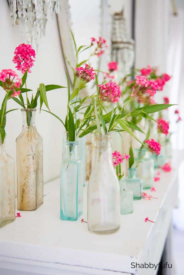 displaying collections of old bottles with flowers