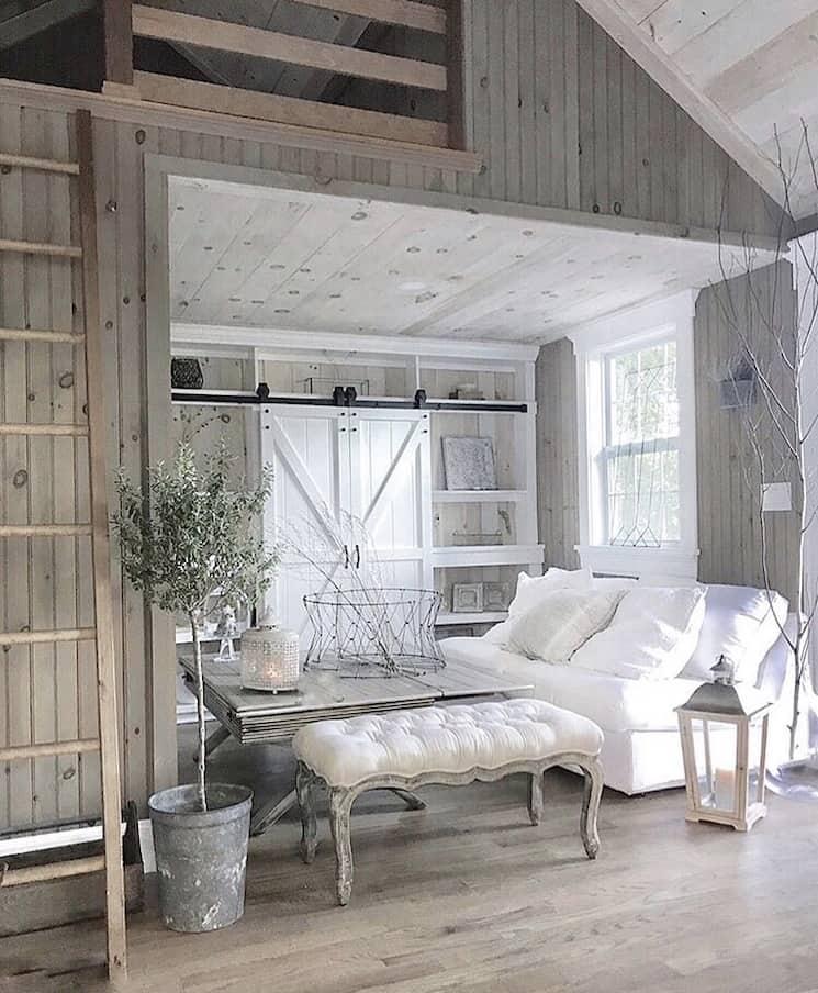 farmhouse with barn doors over tv