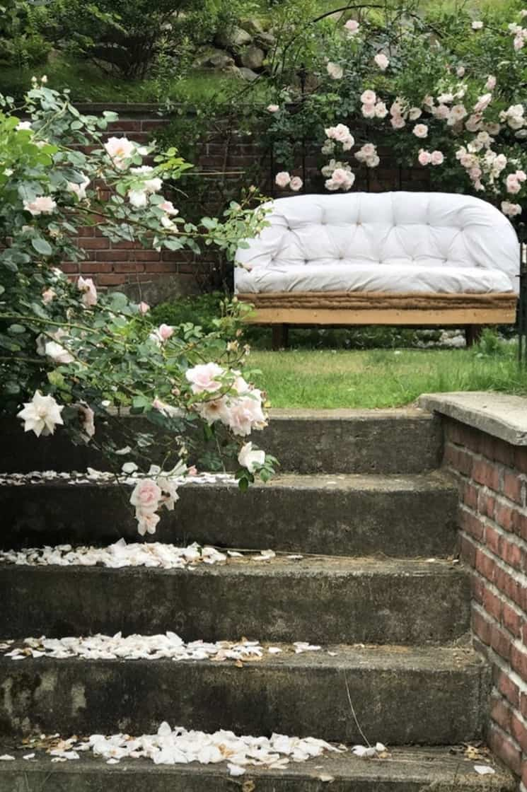 deconstructed sofa in a rose garden