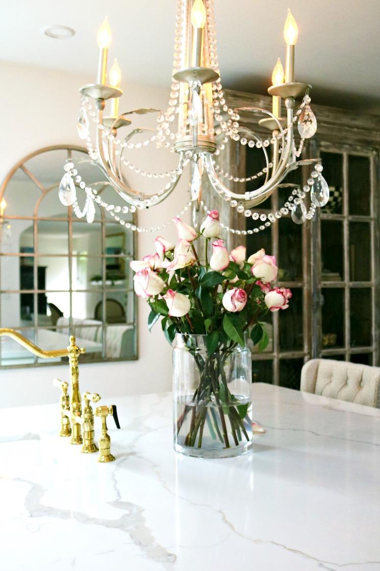 quartz countertop with gold bridge faucet