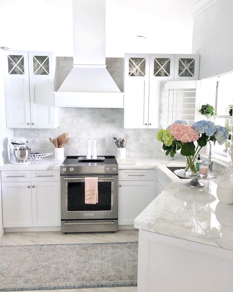 white kitchen with carrara marble