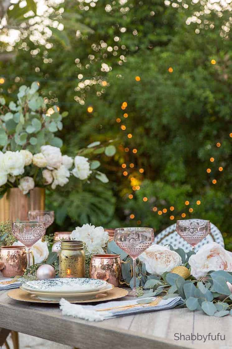 Outdoor table setting with Christmas ball ornaments