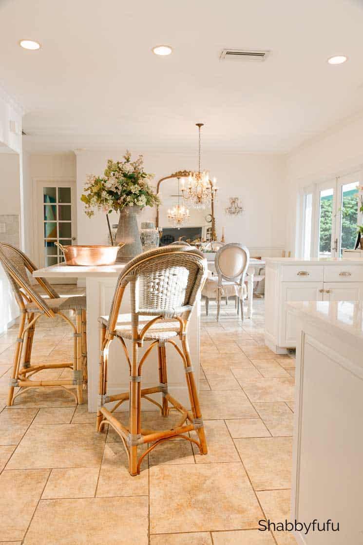 beautiful light-filled kitchen with bistro bar stools at an island