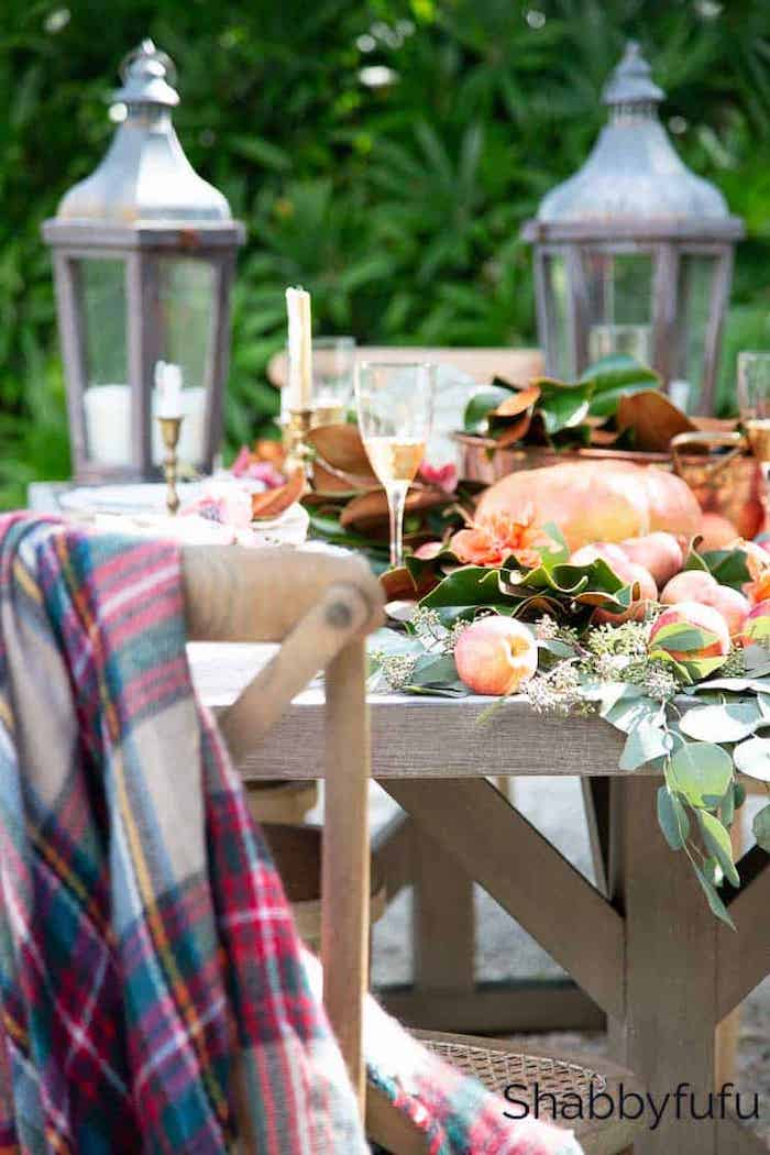 outdoor fall tablescape with tow lanterns