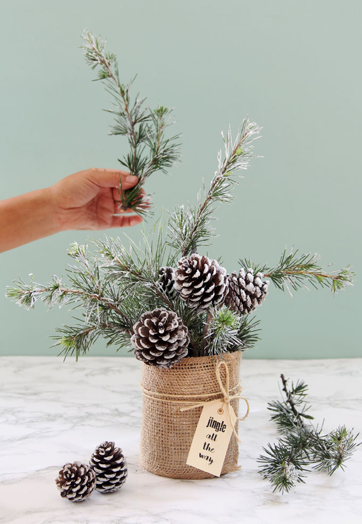 pinecone and pine evergreen arrangement in a burlap wrapped vase