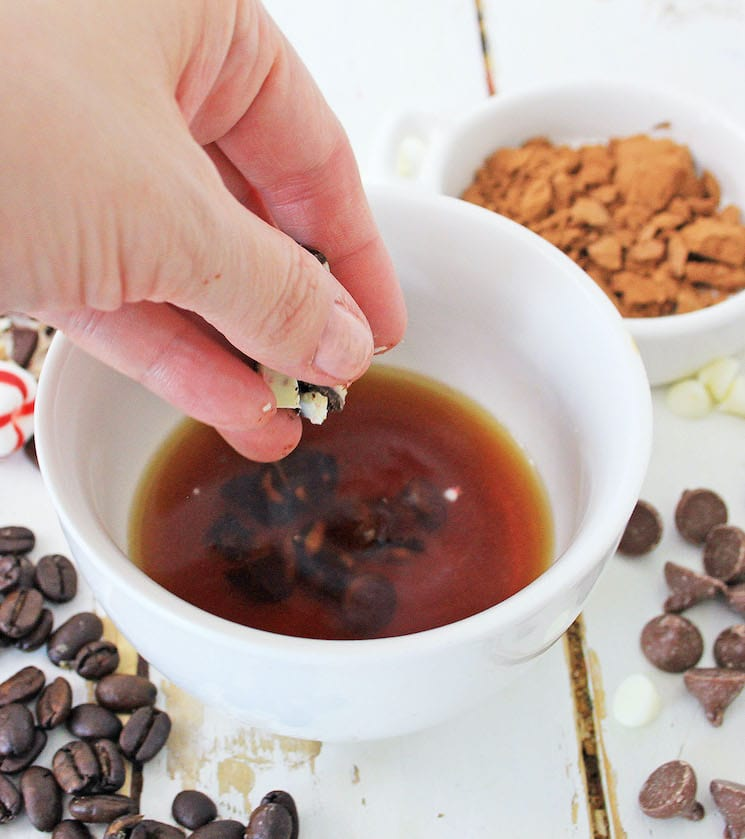 mixing hot peppermint mocha ingredients in a cup