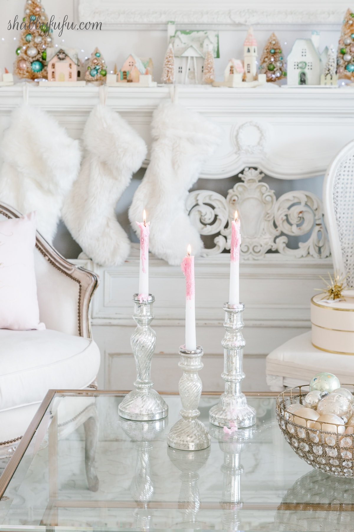 faux fur Christmas stockings on a French mantel