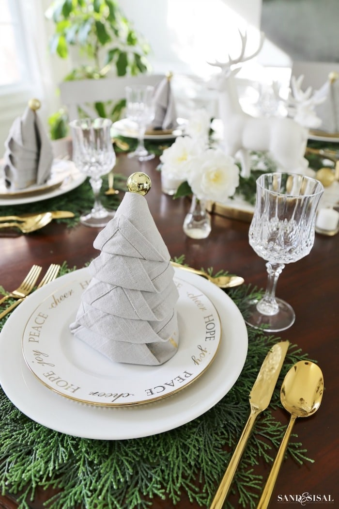Christmas tree napkin fold on a dining room table
