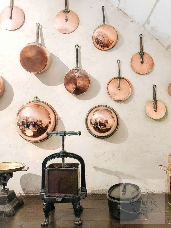 collection of antique copper pans in France