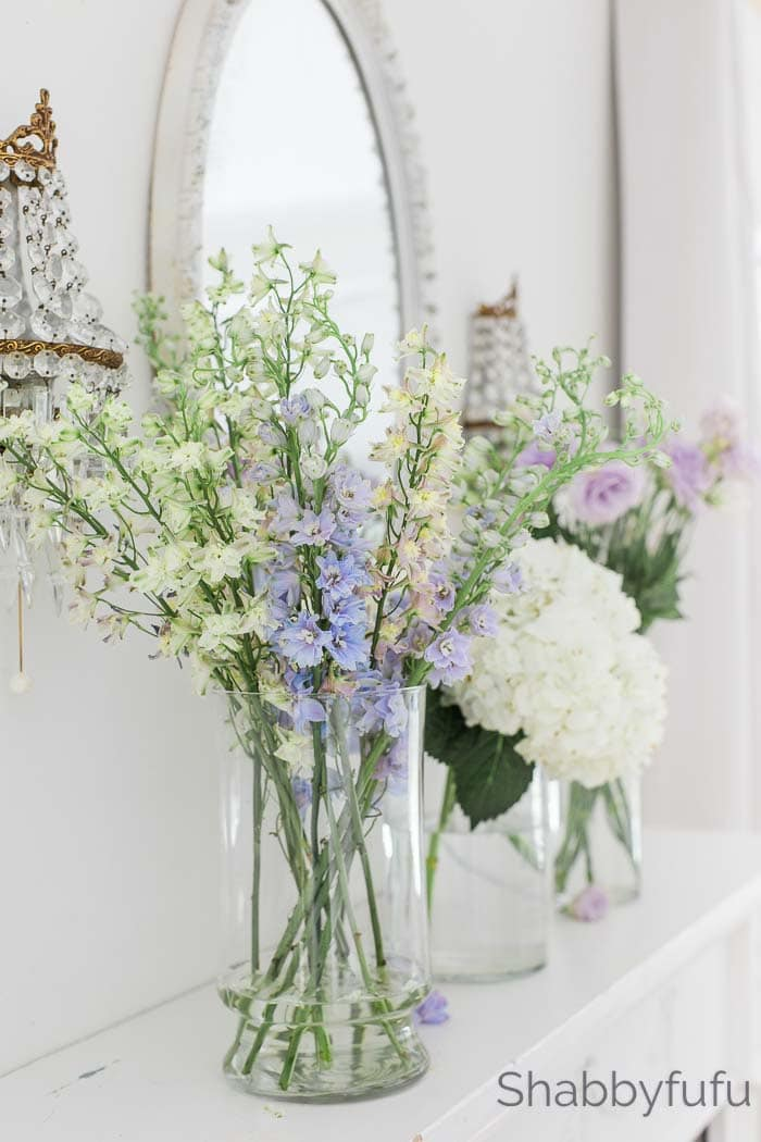 spring home decor flowers on the mantel