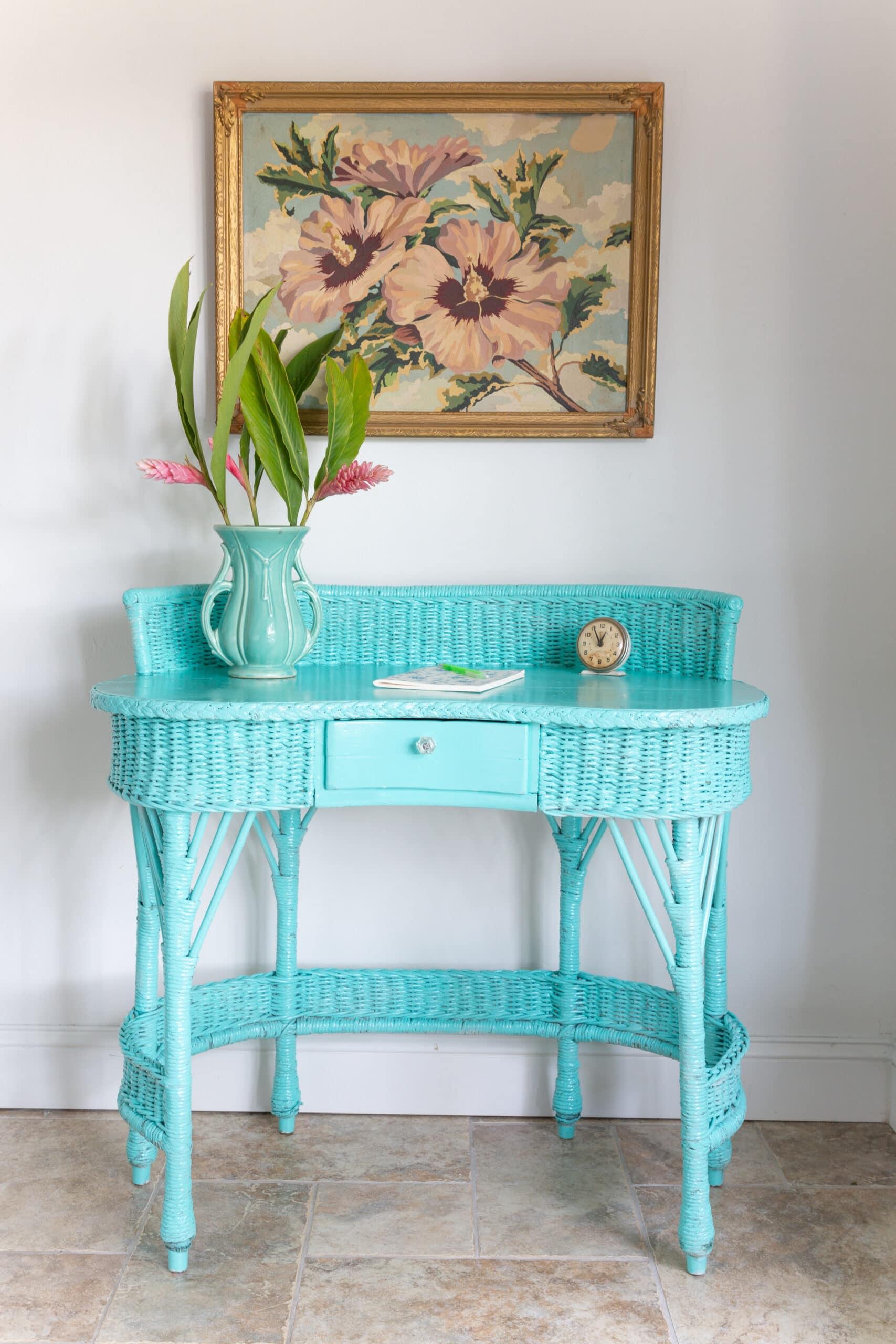 tropical look wicker desk with Behr spray paint in Hidden Sea Glass