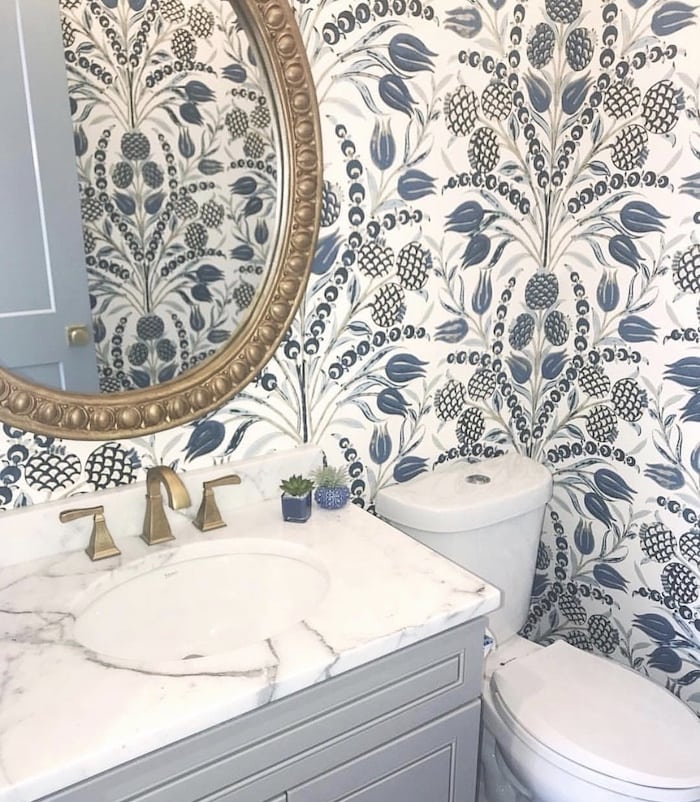 modern powder room with wallpaper