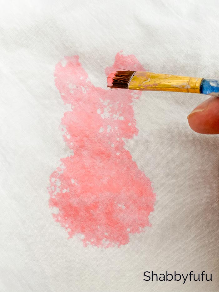 painting with pink food coloring