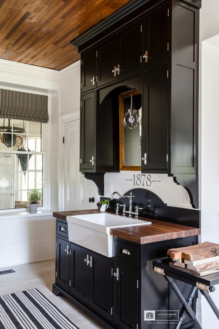 black cabinets in farmhouse kitchen design